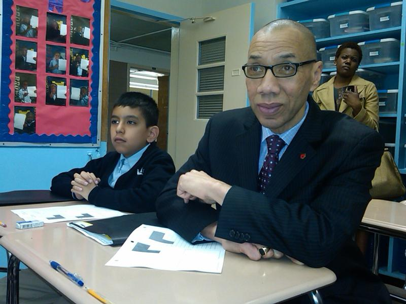 Chancellor Walcott with Harlem Village Academy fifth grader Israel Catalan in East Harlem
